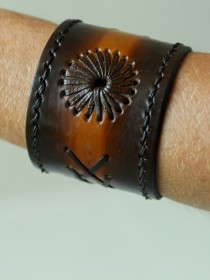 Hand made 100 per cent leather cuffs.